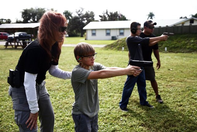 Youth learning gun safety